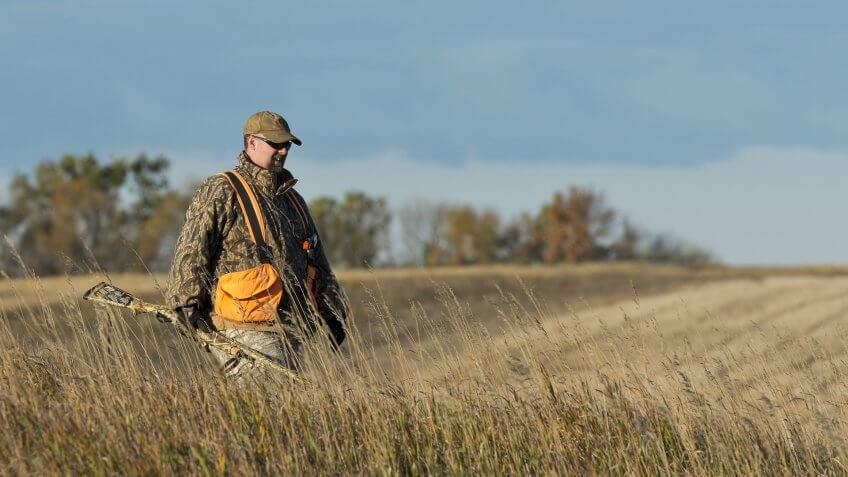 hunter walking in field in Nebraska
