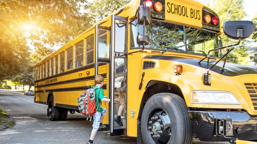 kids getting on a school bus