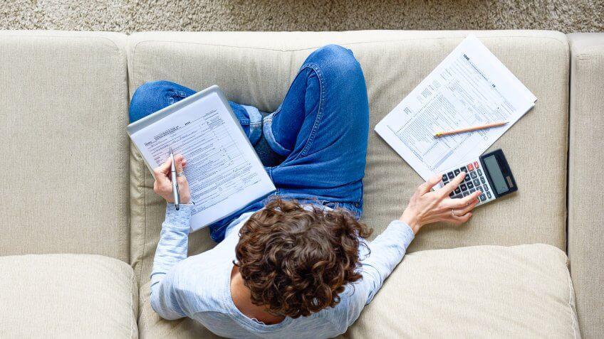 man finishing Tax-preparation at home