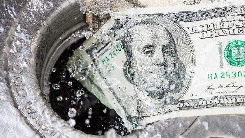 Money being washed down the drain