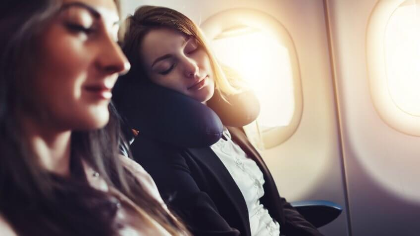 Girlfriends traveling by plane.