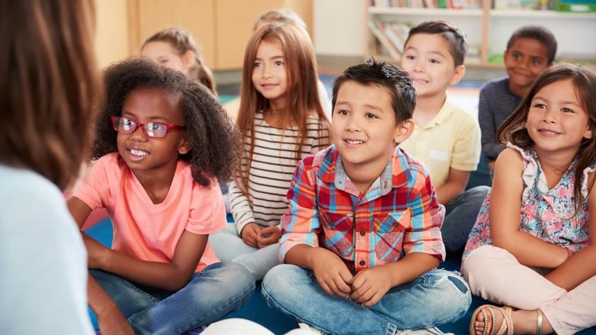 Children in classroom listening to teacher