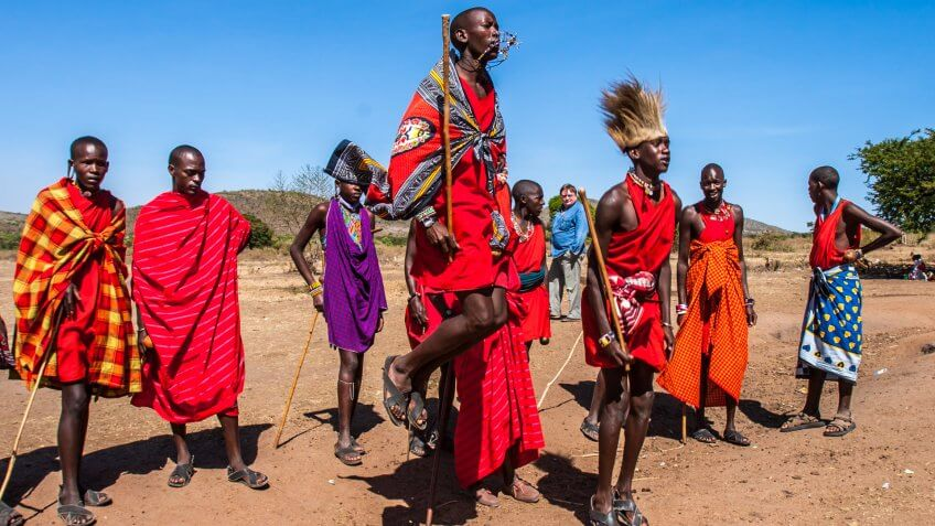 Residents of the Maasai Mara tribe dance the national dance