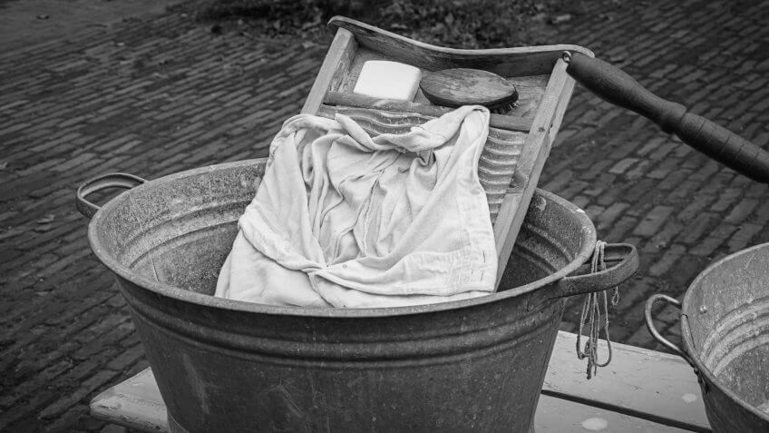The attributes to do the laundry in an old fashioned way.