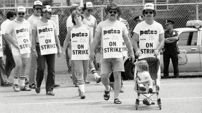 Mandatory Credit: Photo by Handschuh/AP/REX/Shutterstock (6536391b)Striking air traffic controller Bill Haney pushes his two daughters Alison and Meghan, 22-months old, on the picket line at La-Guardia Airport in New York, .