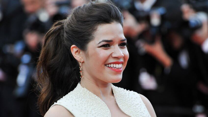 """CANNES, FRANCE - MAY 16, 2014: America Ferrera at the gala premiere of her movie """"How To Train Your Dragon 2"""" at the 67th Festival de Cannes."""