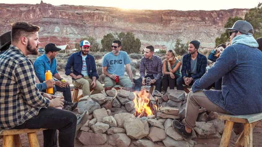 American friends sitting around a campfire