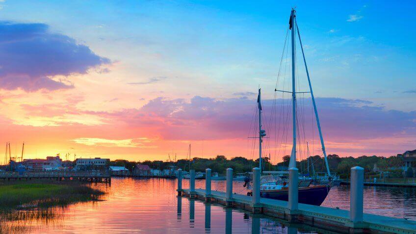 Sunrise Over A Docked Sailboat In Charleston South Carolina.