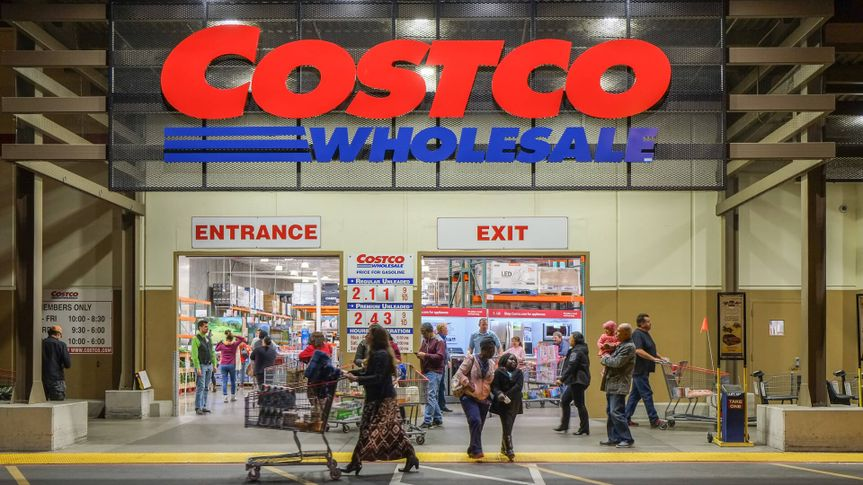 Rancho Cordova, California, USA - December 1, 2016: Late evening shot of people walking in and out of a Costco Wholesale warehouse in Rancho Cordova.