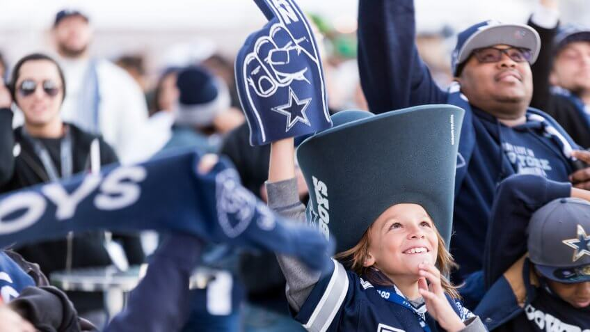 Dallas Cowboys fans cheering at ATT Stadium