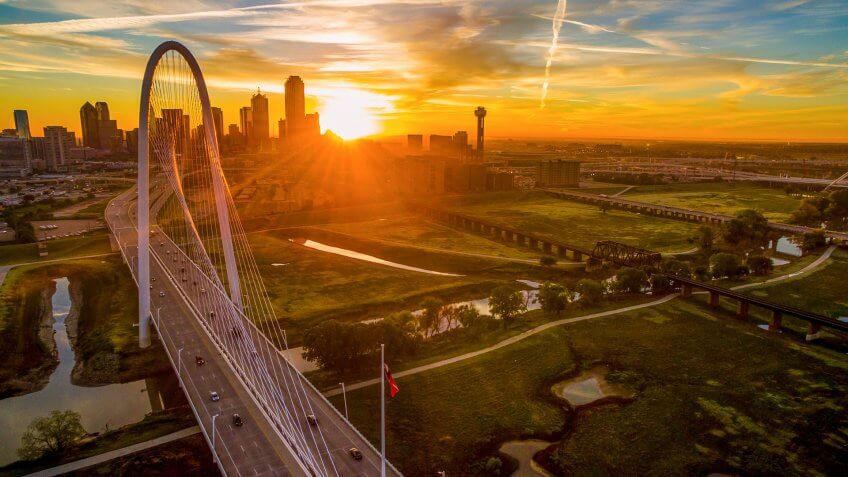 Dallas Texas golden sunrise over Margaret Hunt Hill Bridge.