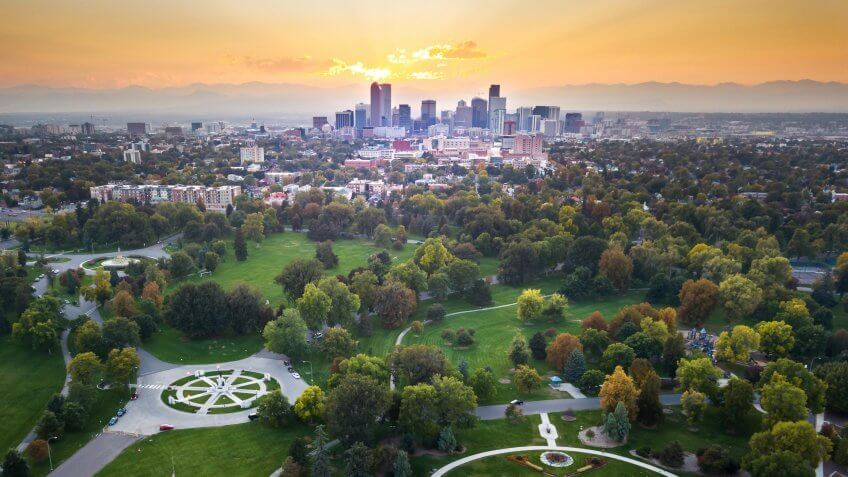 Sunset over Denver cityscape, aerial view from the city park.