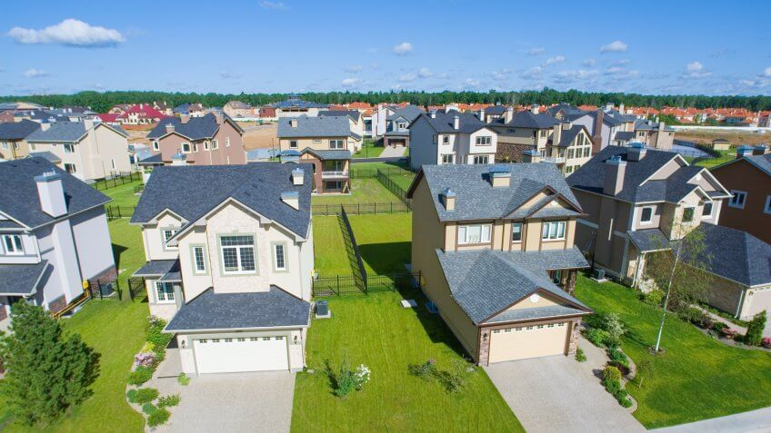 High angle view of several suburban houses in sunny summer afternoon.