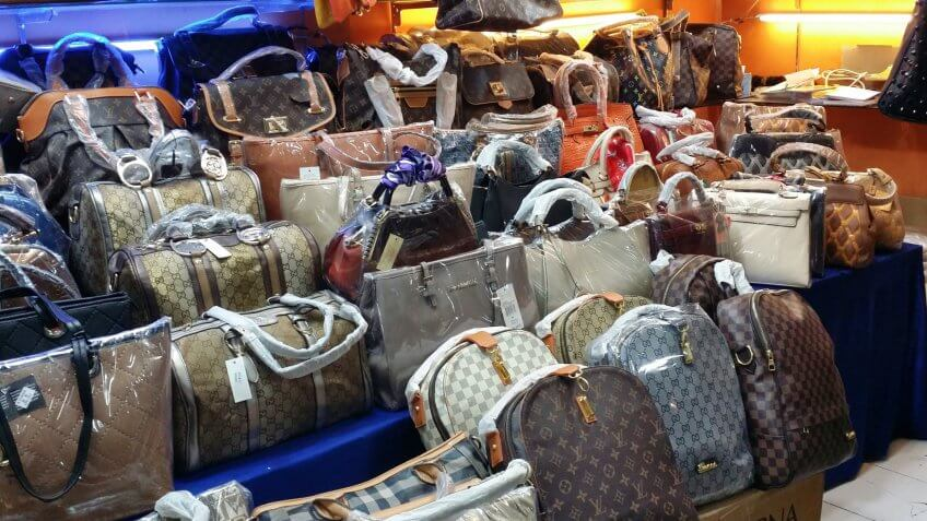 BANDUNG, WEST JAVA ISLAND, INDONESIA -SEPTEMBER 16, 2014: Large collection of famous fake handbags on display at one of the shopping centres in Bandung.