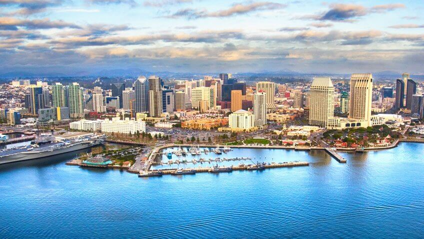 The skyline of downtown San Diego, California shot from an orbiting helicopter of San Diego Bay.
