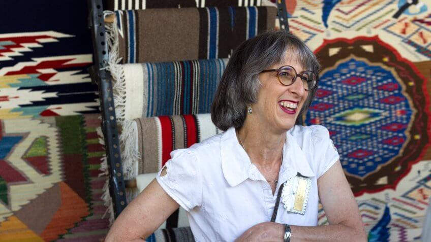Santa Fe, NM, USA - July 29, 2017: Lisa Trujillo, a New Mexico weaver, sells her textiles at the 2017 Spanish Market in Santa Fe, NM.