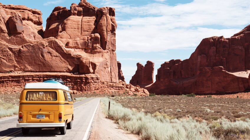 Vintage van driving through southwest landscape