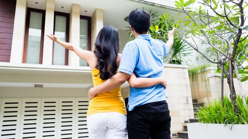 couple excited about house.