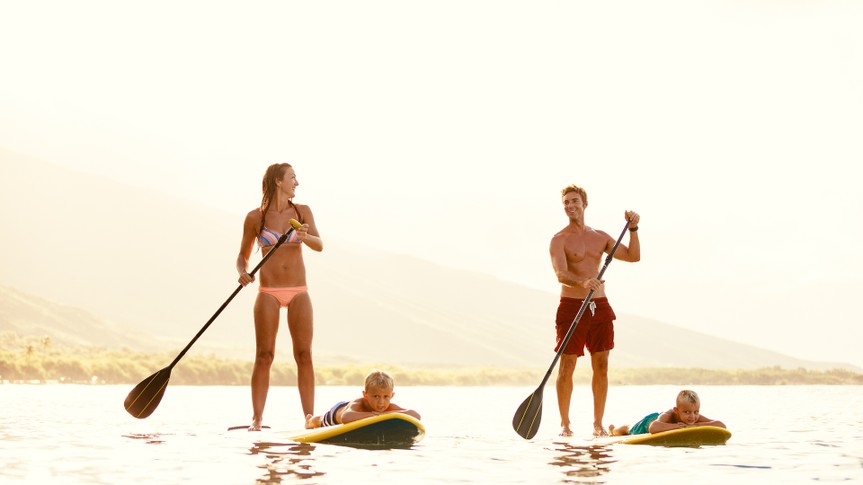 family paddle boarding in Hawaii