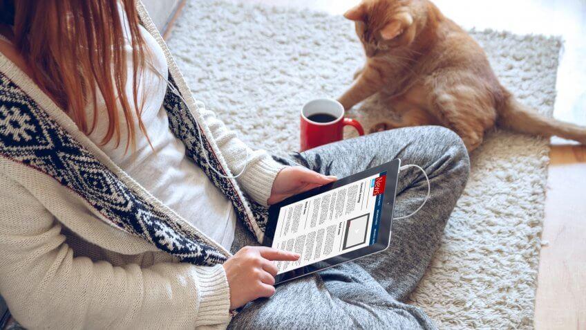 girl reading news on tablet