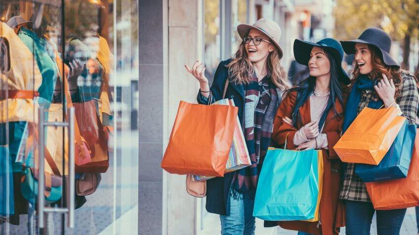 Young women enjoying a window shopping.