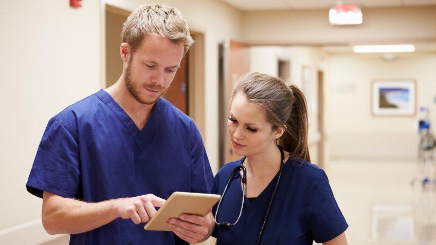 male nurse talking with female nurse