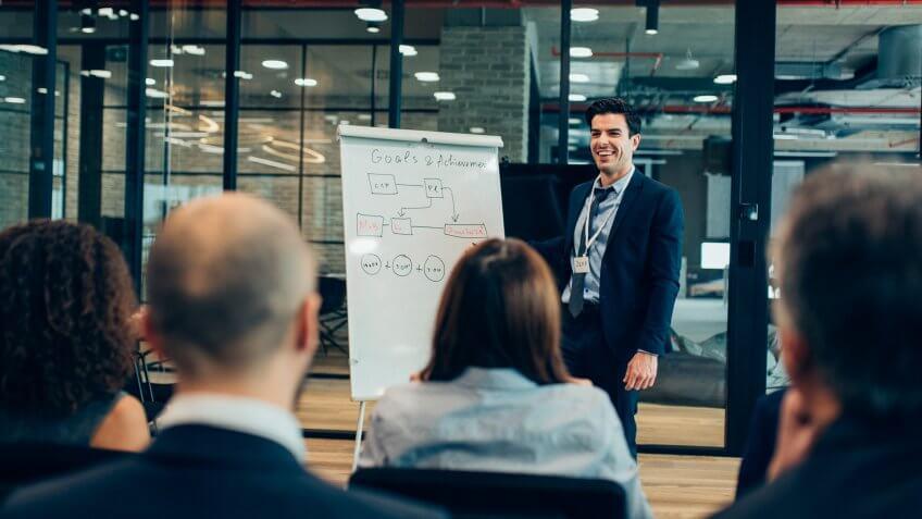Businessman giving flipchart business presentation.