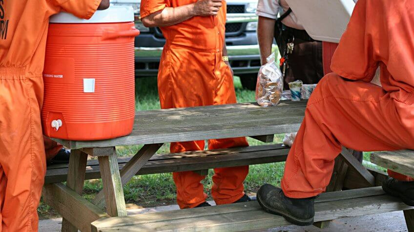 Inmates taking a break from community service work.