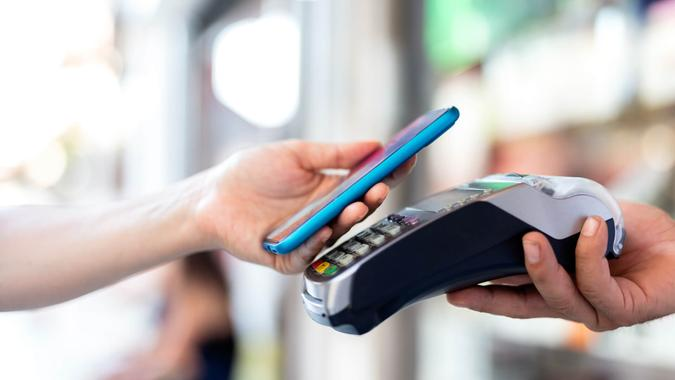 person paying tab with mobile credit card