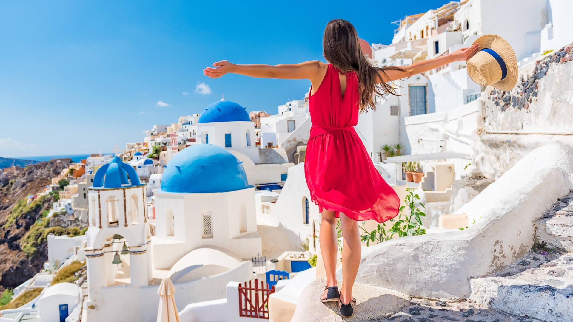 woman traveling to Santorini Greece