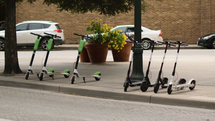 dockless electric scooters on a sidewalk