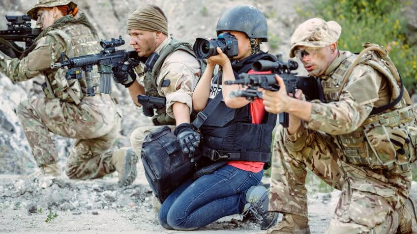 photojournalist among soldiers on the warfront