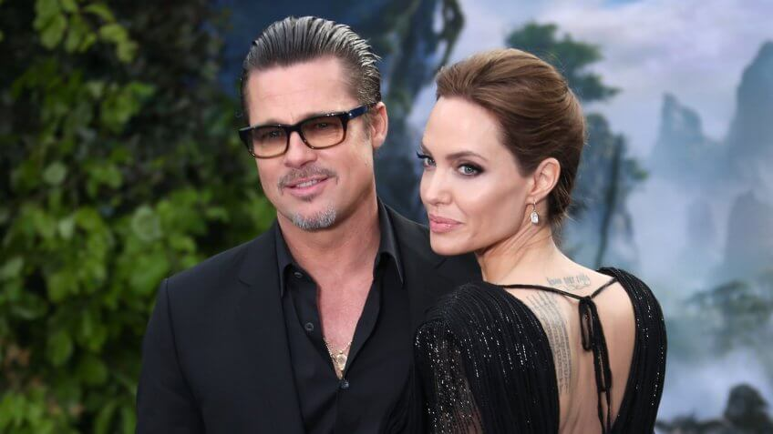 Mandatory Credit: Photo by Photo by Joel Ryan/Invision/AP/REX/Shutterstock (9088141l)Actors Brad Pitt and Angelina Jolie pose for photographers as they arrive for the Maleficent exhibit in Kensington Gardens, in west London, .