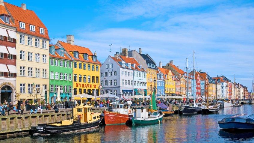 COPENHAGEN, DENMARK - APRIL 13, 2010: Colorful facades along Nyhavn.