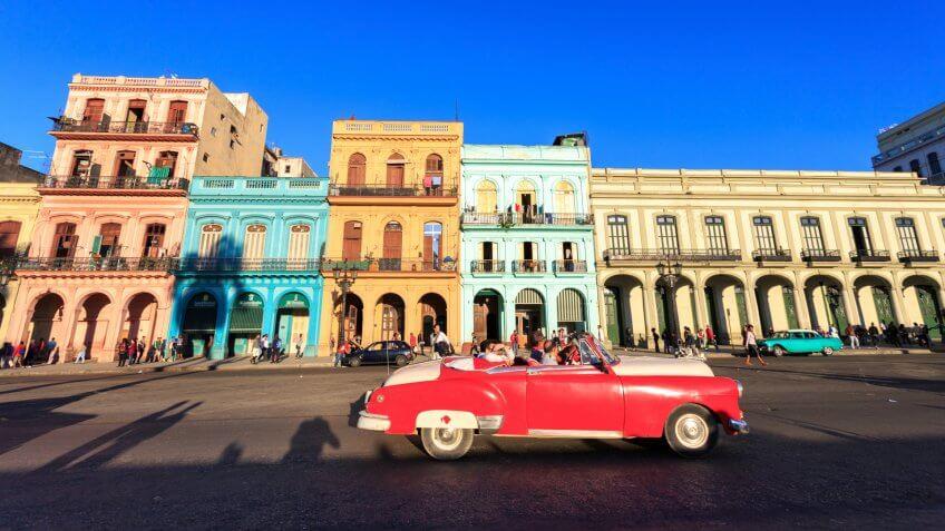 HAVANA - FEB 5: Classic red Car in Old Havana main street, on February 5th, 2015 Havana, Cuba.