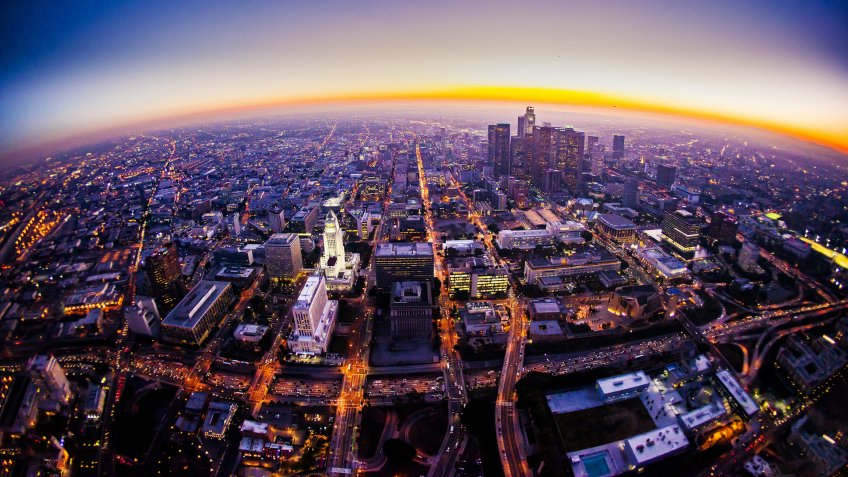 Aerial view of Los Angeles Skyline at sunset from a helicopter.