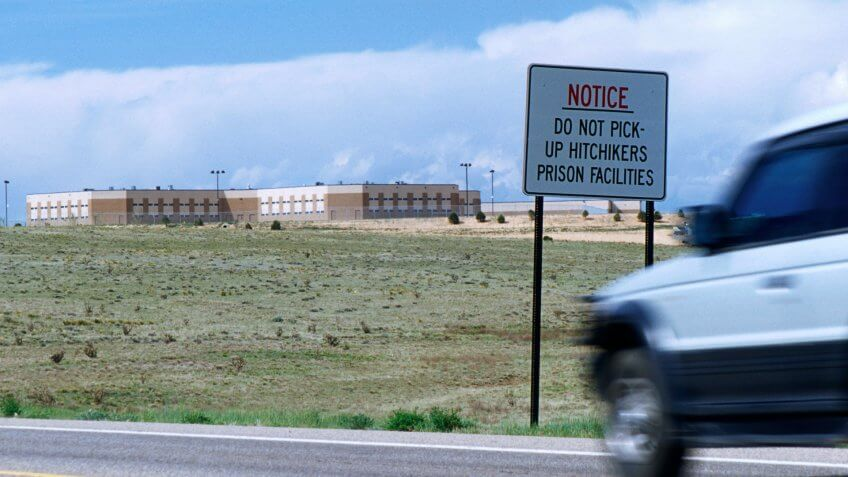 Do not pick-up hitchikers sign on a road passing by prision facilities in New Mexico, USA.