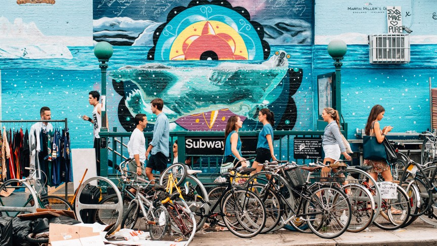 New York City, United States - August 30, 2015: People getting in and out of the subway in Williamsburg in Brooklyn.