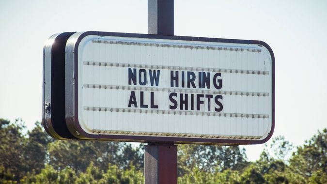 A business openly advertises work opportunities.