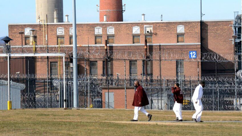 Mandatory Credit: Photo by Marc Levy/AP/REX/Shutterstock (7898351a)Inmates walk across a yard at the State Correctional Institution at Camp Hill, Pennsylvania, where a newly cleared wing is set to house inmates from other prisons that could close, in Camp Hill, PaPrison Pennsylvania, Camp Hill, USA - 13 Jan 2017.