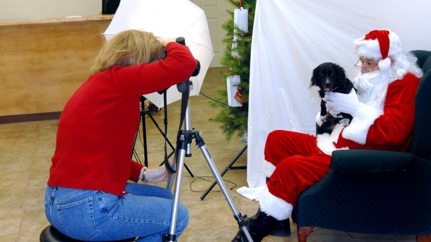 Santa Claus helper taking photo