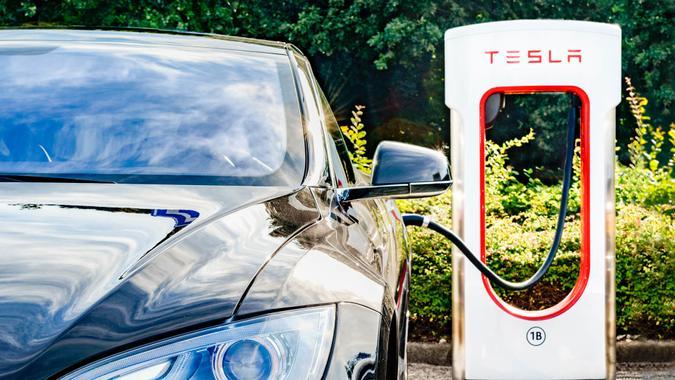 Zevenaar, The Netherlands - September 10, 2015: Black Tesla Model S electric car at a Tesla supercharger charging station.