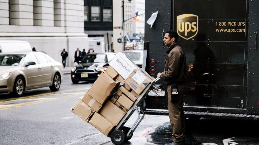 UPS worker delivering packages