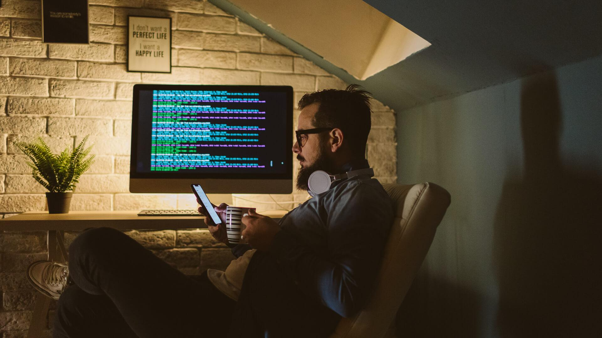 Programmer working late in his office.