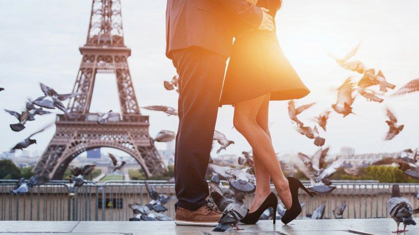 couple near Eiffel tower in Paris, romantic kiss.