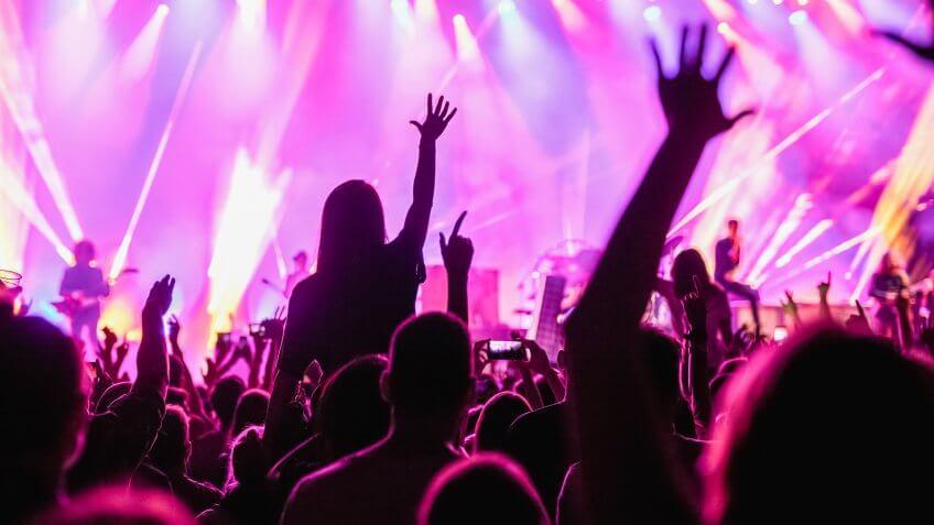 Crowd raising hands in the air on the music festival.