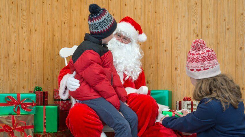 kid sitting on Santa Claus lap
