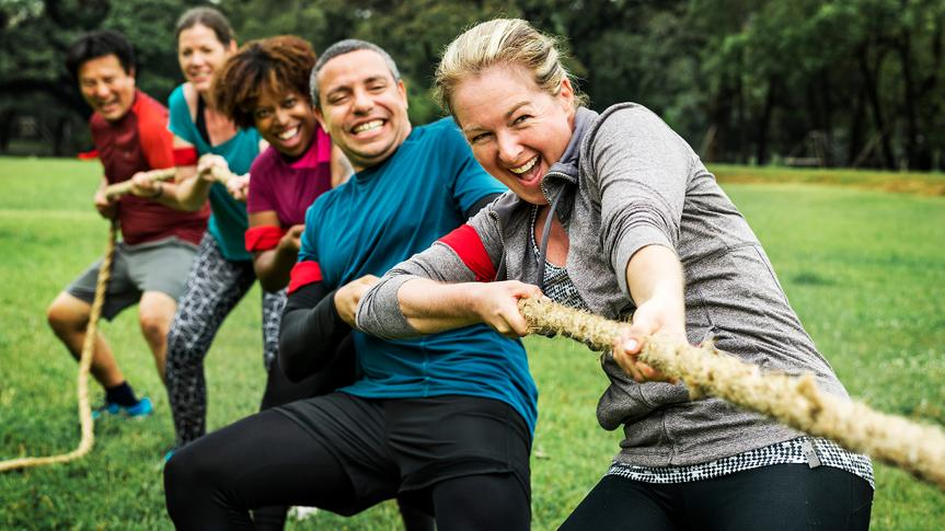 Team competing in tug of war - Image.