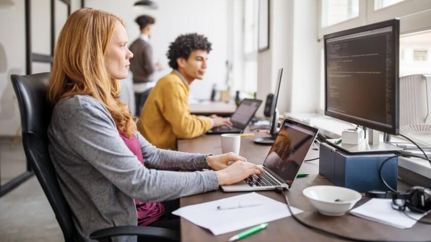 Female professional working on new software program.