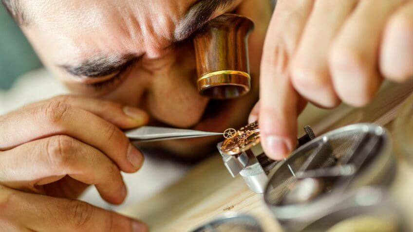 portrait of a watchmaker at work.